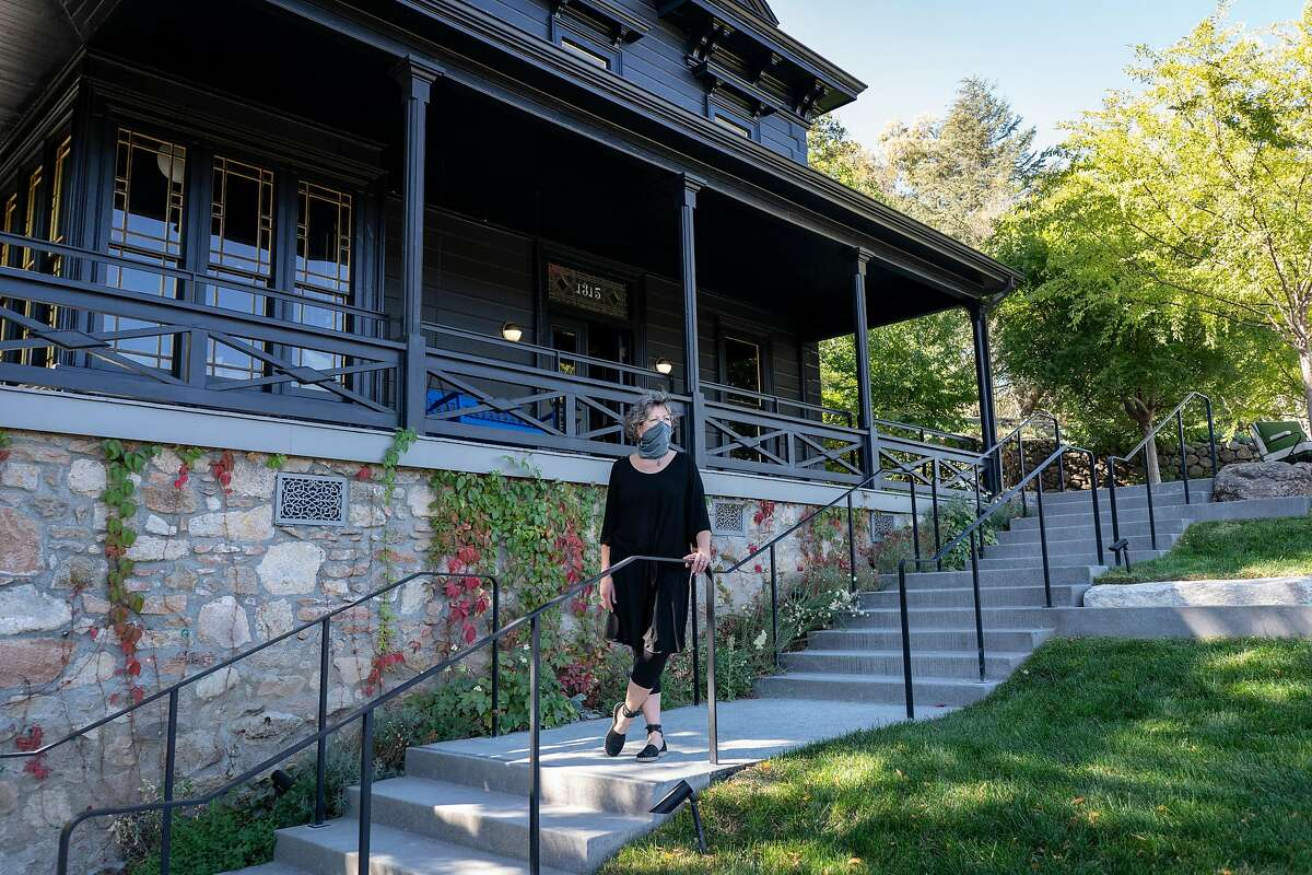 Kim Wertz stands outside the Faust Haus in St. Helena, California.