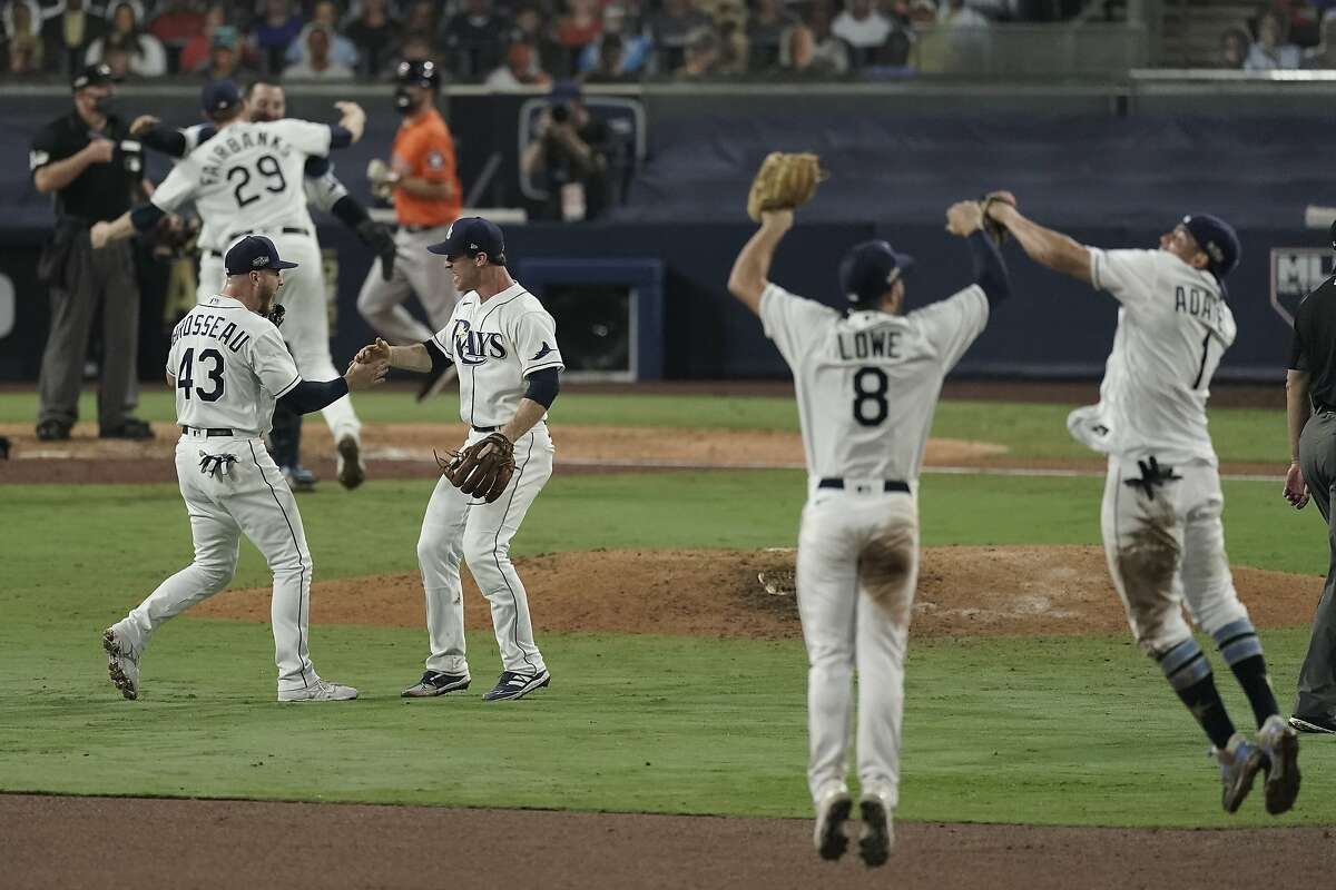 Tampa Bay Rays celebrate their victory against the Houston Astros in Game 7 of a baseball American League Championship Series, Saturday, Oct. 17, 2020, in San Diego. The Rays defeated the Astros 4-2 to win the series 4-3 games.