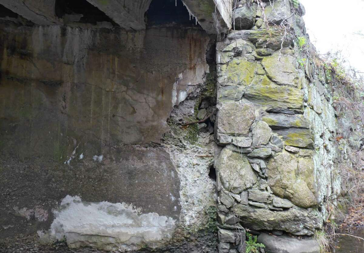 Although the Lovers Lane bridge's abutment going down to the Comstock Brook shows deterioration, portions of it will remain when the new bridge is built. Members of the Architectural Review Board said they would like the parapet up top to echo that stone work.