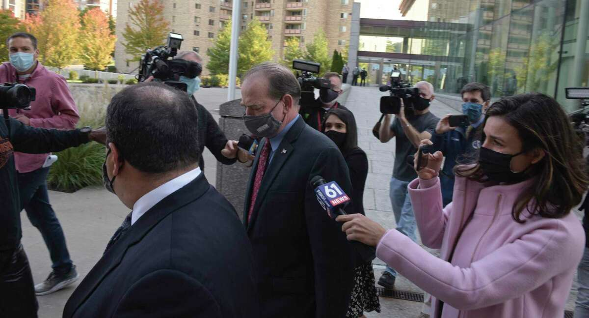 Kent Mawhinney, center, the attorney charged in the Jennifer Dulos case, was released on bond today. He was brought to Superior Court where he posted bond and was fitted with a GPS monitor. Monday, October 19, 2020, Stamford, Conn.