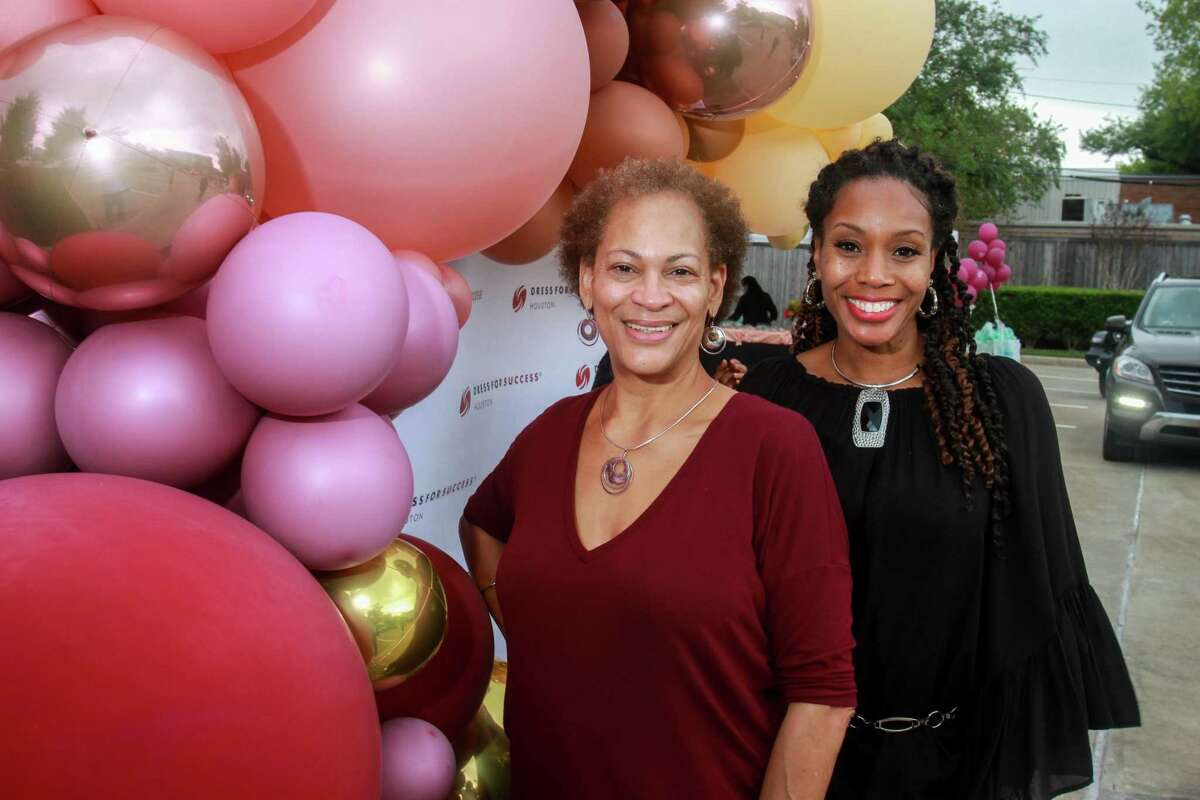 Mira Crenshaw, left, and Beverley Benford at the Dress for Success annual October celebration, a drive-thru soiree at DFSH on October 17, 2020.
