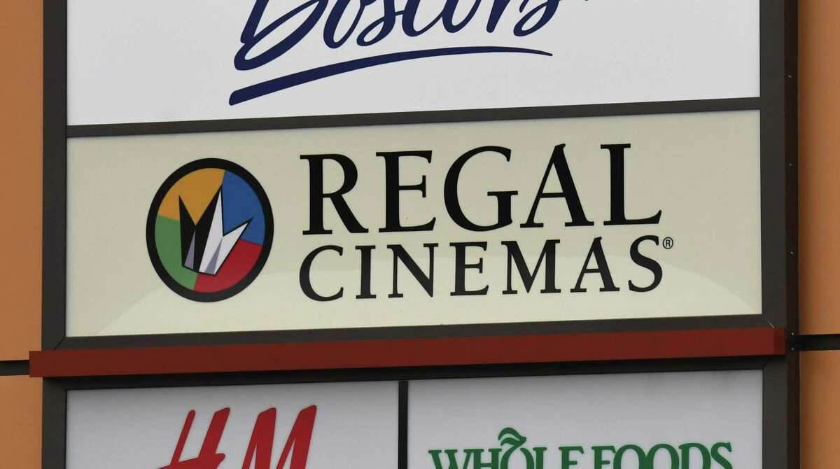 A sign for Regal Cinemas movie theater at Colonie Center is seen on Monday, Oct. 19, 2020, on Wolf Road in Colonie, N.Y. The Colonie Center cinemas will reopen April 16, Regal announced. (Will Waldron/Times Union)