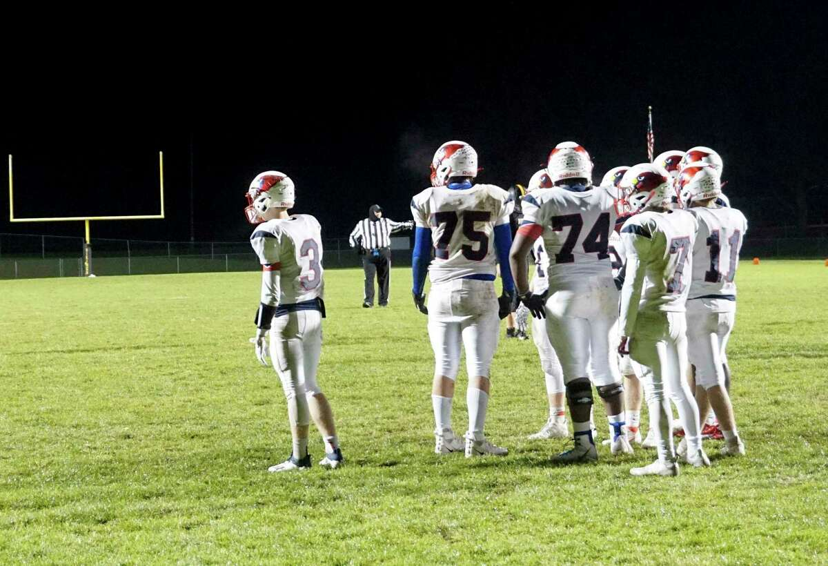 Big Rapids huddles and waits for a signal from the sideline during its 29-22 win over Tri County last Friday night. (Pioneer photo/Joe Judd)