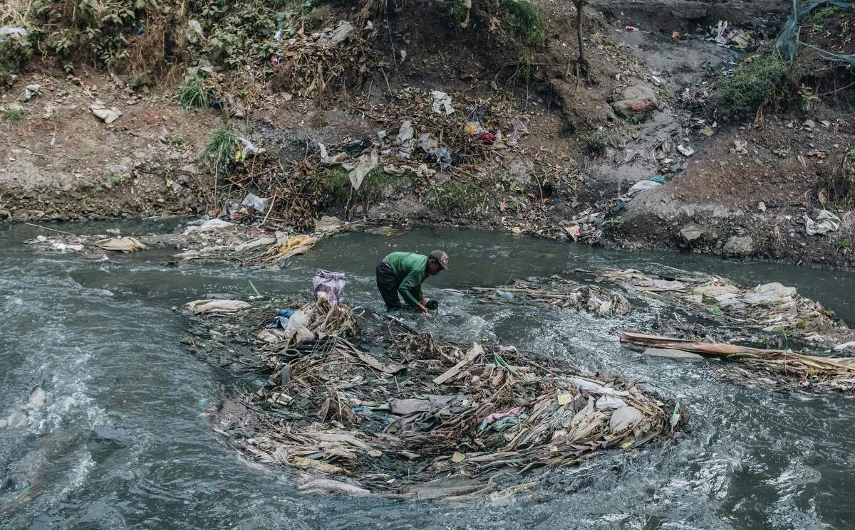Plastic waste in the Nairobi River in Nairobi, Kenya, Aug. 3, 2020. Faced with plunging profits and a climate crisis that threatens fossil fuels, the fossil fuel industry is demanding a trade deal that weakens Kenya's rules on plastics and on imports of American trash.