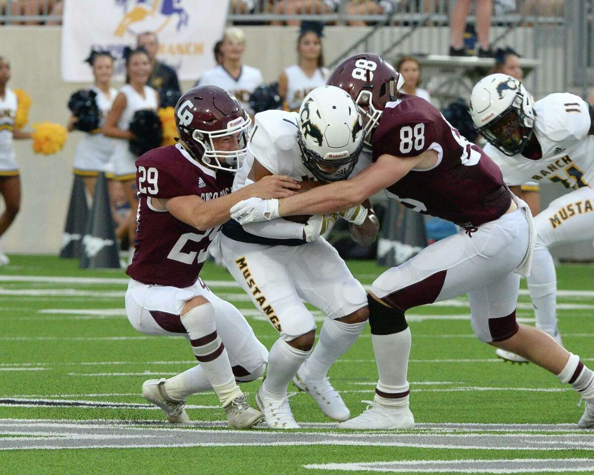 Landon King (29) and Michael Schaefer (88) of Cinco Ranch combine to tackle Elias Pino (1) of Cy Ranch in the first quarter of a high school football game between the Cinco Ranch Cougars and the Cy Ranch Mustangs on Saturday, August 31, 2019 at Legacy Stadium, Katy, TX.