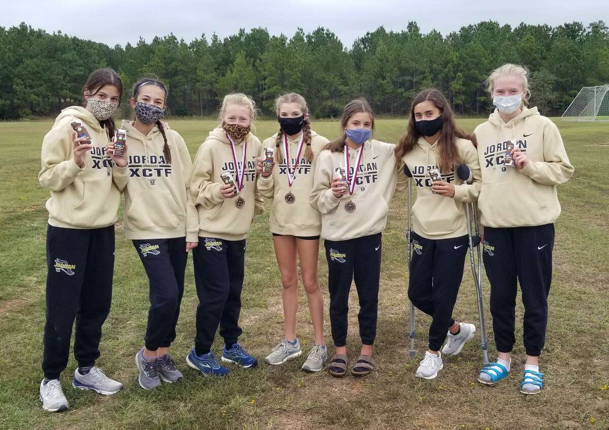 The Jordan girls cross country team was the runner-up in the top varsity division of the Run the Dog Pound Invitational in Magnolia.