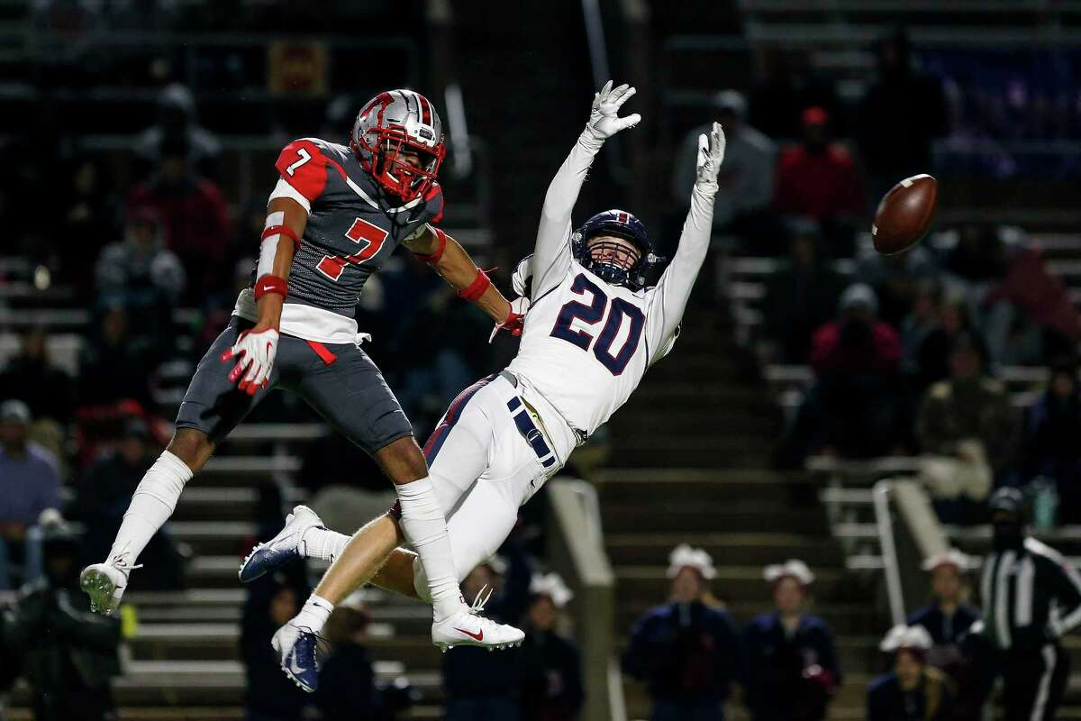 Travis Tigers strong safety Cam Moore (7) breaks up a pass intended for Tompkins Falcons fullback Garrett Mack (20) during the second half of the high school football playoff game between the Tompkins Falcons and the Travis Tigers at Mercer Stadium in Sugar Land, TX on Thursday, November 14, 2019. The Falcons defeated the Tigers 35-28.