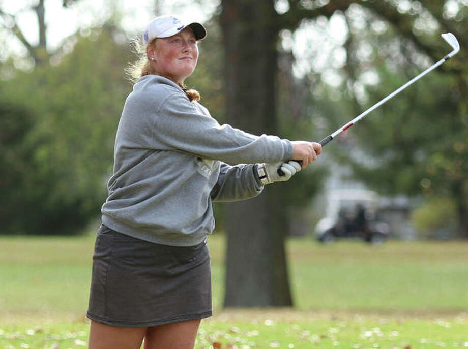 Marquette Catholic's Gracie Piar watches her second shot on the 18th hole just miss the green in last week's Class 1A sectional at Salem Country Club. Piar bogeyed the hole to finish at 72. Photo: Greg Shashack | The Telegraph
