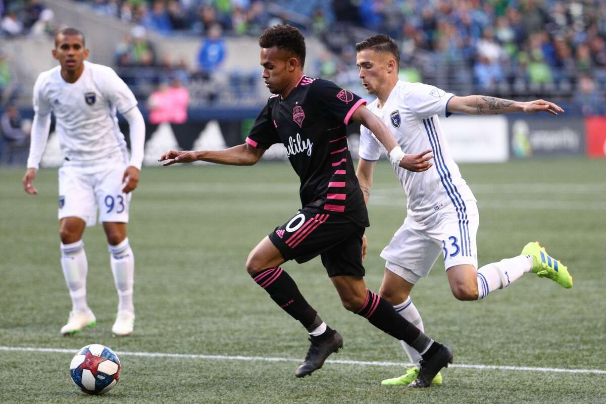 SEATTLE, WASHINGTON - APRIL 24: Handwalla Bwana #70 of Seattle Sounders and Paul Marie #33 of San Jose Earthquakes chase the ball in the first half during their game at CenturyLink Field on April 24, 2019 in Seattle, Washington. (Photo by Abbie Parr/Getty Images)