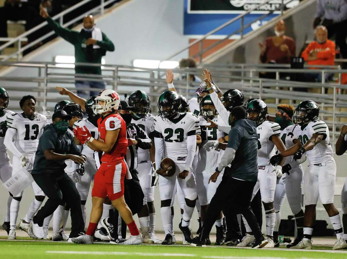 Fort Bend Hightower players react after a cornerback Julian Payne's second interception of the game during the fourth quarter of a non-district high school football game at Woodforest Bank Stadium on Friday in Shenandoah.