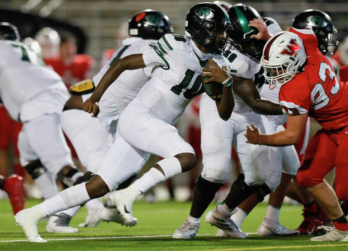 Fort Bend Hightower quarterback Jakolby Longino (10) runs for a first down during the fourth quarter of a non-district high school football game at Woodforest Bank Stadium, Friday, Oct. 156 2020, in Shenandoah.