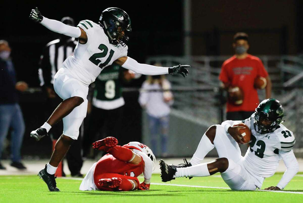 Fort Bend Hightower cornerback Matthew Aneke (21) reacts after an interception by cornerback Julian Payne (23) during the second quarter of a non-district high school football game at Woodforest Bank Stadium, Friday, Oct. 156 2020, in Shenandoah.