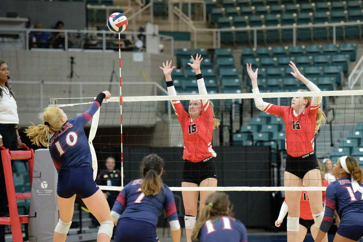 Maddie Waak (16) and Jordan Gamble (15) of Katy try to block the shot being made by Kylie Mueller (10) of Dulles during the fourth set of a Class 6A Region III bi-district volleyball playoff match between the Dulles Vikings and the Katy Tigers on Monday, November 4, 2019 at the Leonard Merrell Center, Katy, TX.