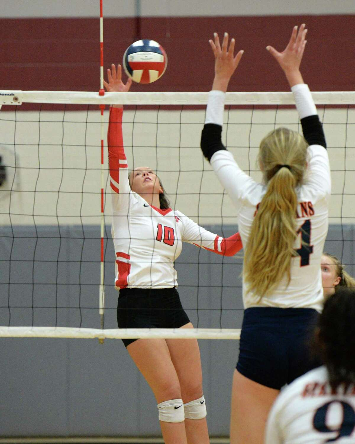 Abby Sherman (10) of Katy attempts a shot past Ally Batenhorst (14) of Seven Lakes during the second set of a volleyball match between the Seven Lakes Spartans and the Katy Tigers on Friday, August 9, 2019 at Cinco Ranch HS, Katy, TX.