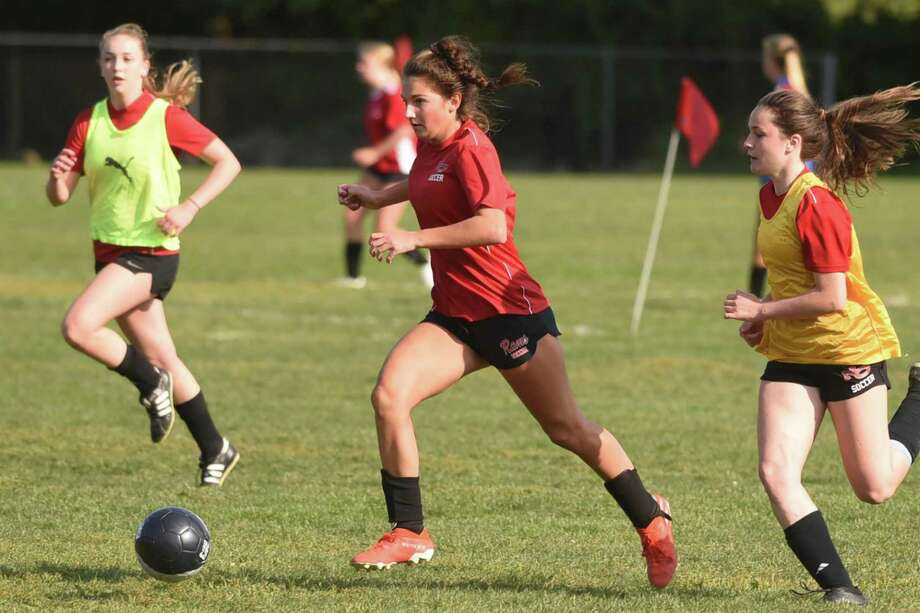 New Canaan's Kaleigh Harden races toward the goal during girls soccer practice at the Saxe School fields on Monday, Sept. 21, 2020. Photo: Dave Stewart / Hearst Connecticut Media / Hearst Connecticut Media