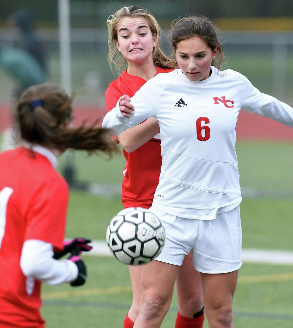 Isabel Dziura (left) of Cheshire and Kaleigh Harden of New Canaan fight for the ball on November 14, 2019 in a Class LL tournament game in Cheshire.