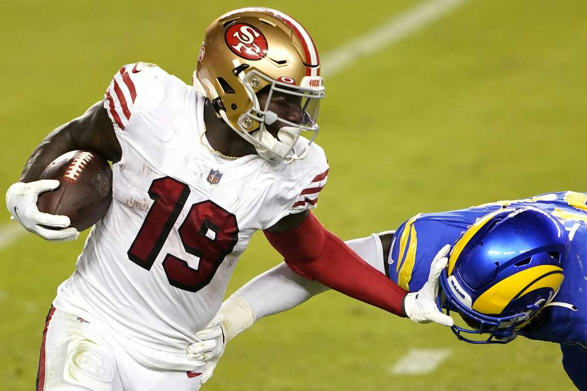 Deebo Samuel of the San Francisco 49ers pushes off Leonard Floyd of the Los Angeles Rams during the third quarter at Levi's Stadium on Oct. 18, 2020, in Santa Clara, Calif.