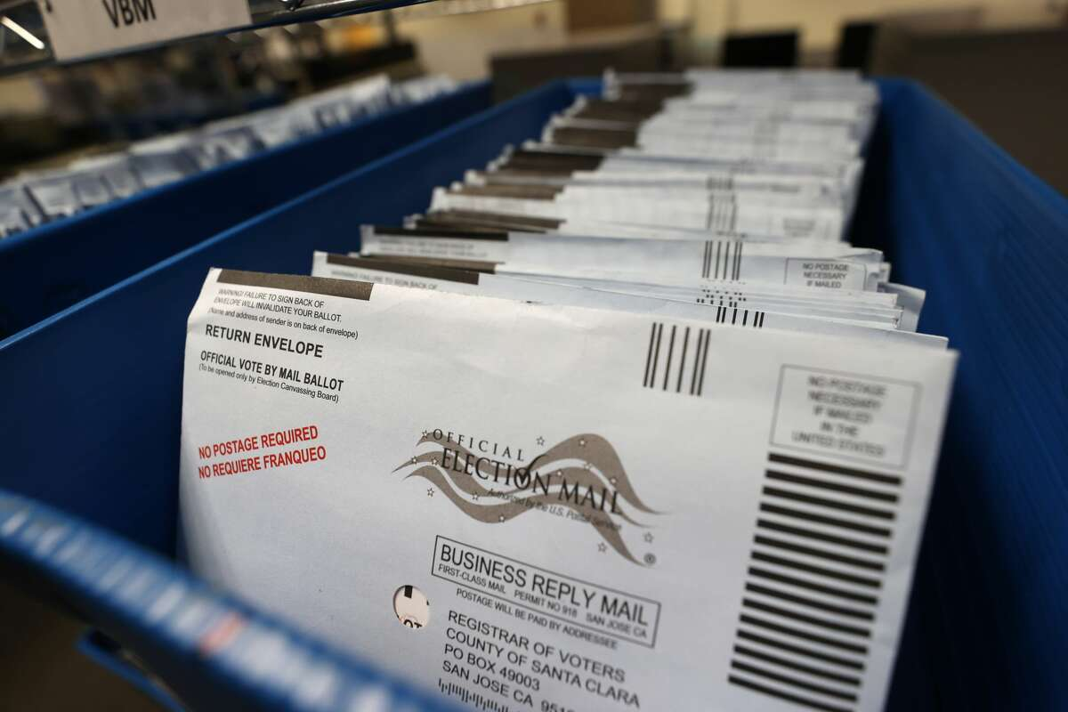 Mail-in ballots sit in trays before being sorted at the Santa Clara County Registrar of Voters office on Oct. 13, 2020, in San Jose, Calif. The Santa Clara County Registrar of Voters is preparing to take in and process thousands of ballots as early voting is underway in the state of California.