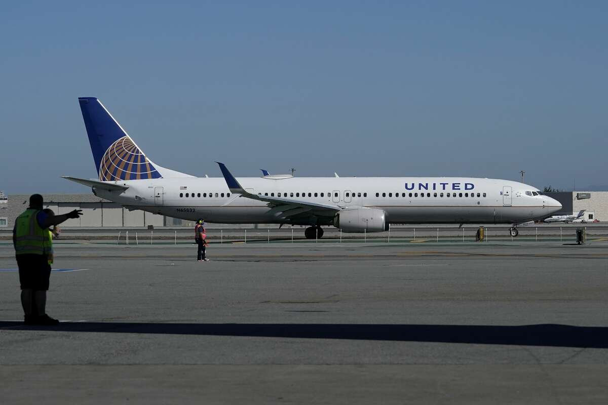 A United Airlines airplane waits to take off on the runway at San Francisco International Airport in San Francisco, Thursday, Oct. 15, 2020.