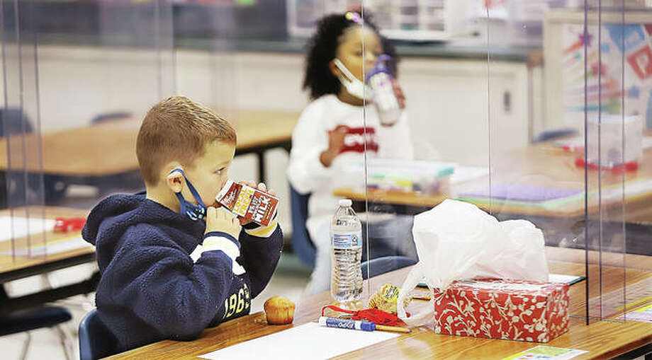 Inside classrooms at Gilson Brown School in Godfrey Monday, students had their breakfasts at their desks — which are now sided by plexiglass to contain any airborne germs. The first day of in-school classes went off like a well-oiled machine Monday.