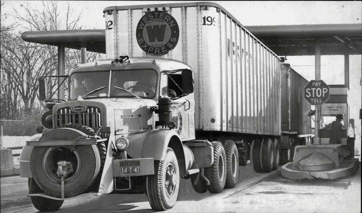 A Western Express Company tandem truck leaving a toll booth and entering the New York State Thruway. Feb. 05, 1959.