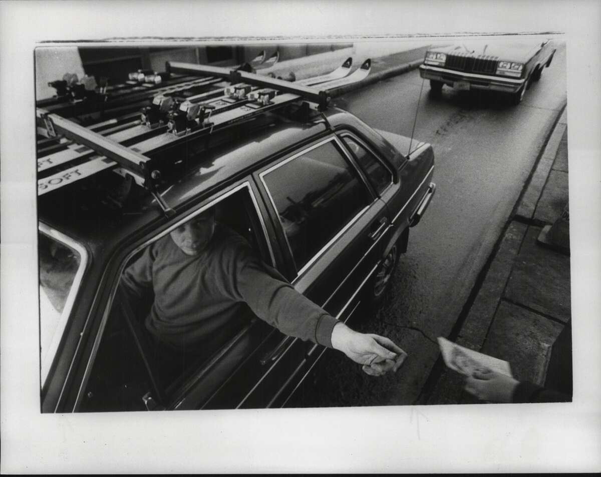 Driver pays a toll at Exit 24 of the Thruway in Albany. Dec. 01, 1984.