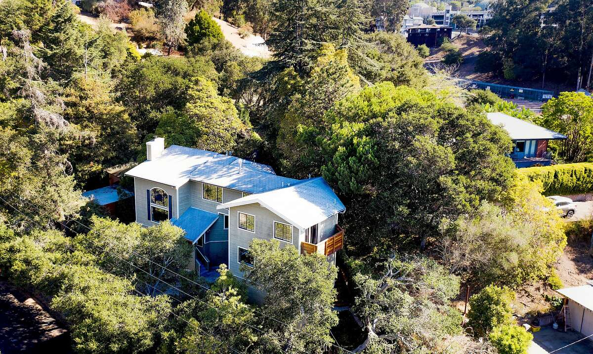 A recently sold Oakmore neighborhood home rests among trees in Oakland. Many homes are selling in less than two weeks.