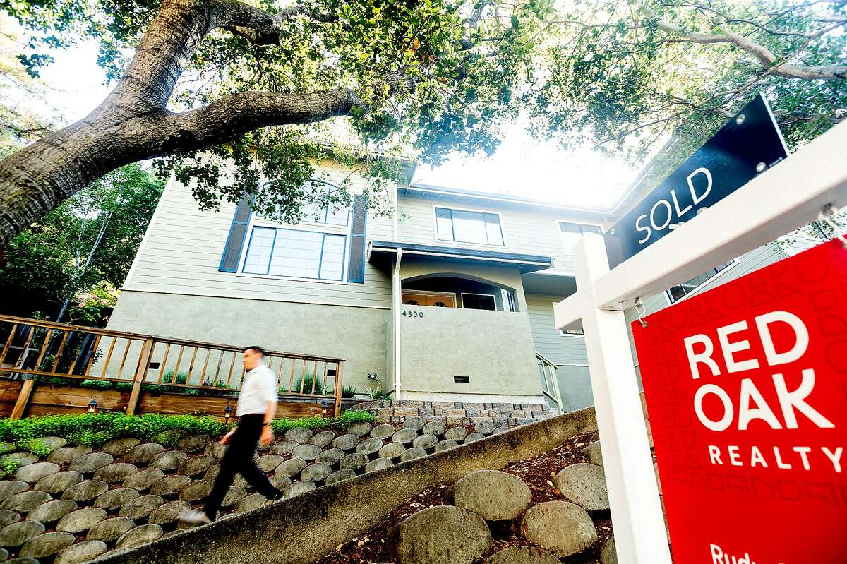 Real estate agent Justin Palmer leaves an Oakland home he recently helped San Francisco buyers purchase in Monday.