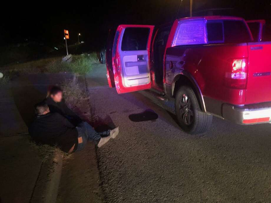 U.S. Border Patrol agents said this red pickup was loaded with immigrants who had crossed the border illegally. Agents apprehended the immigrants following a vehicle pursuit. Photo: Courtesy Photo /U.S. Border Patrol
