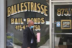 Front window of the Ballestrasse bail bond company across the street from the Hall of Justice seen on Tuesday, Sept. 22, 2020, in San Francisco, Calif.