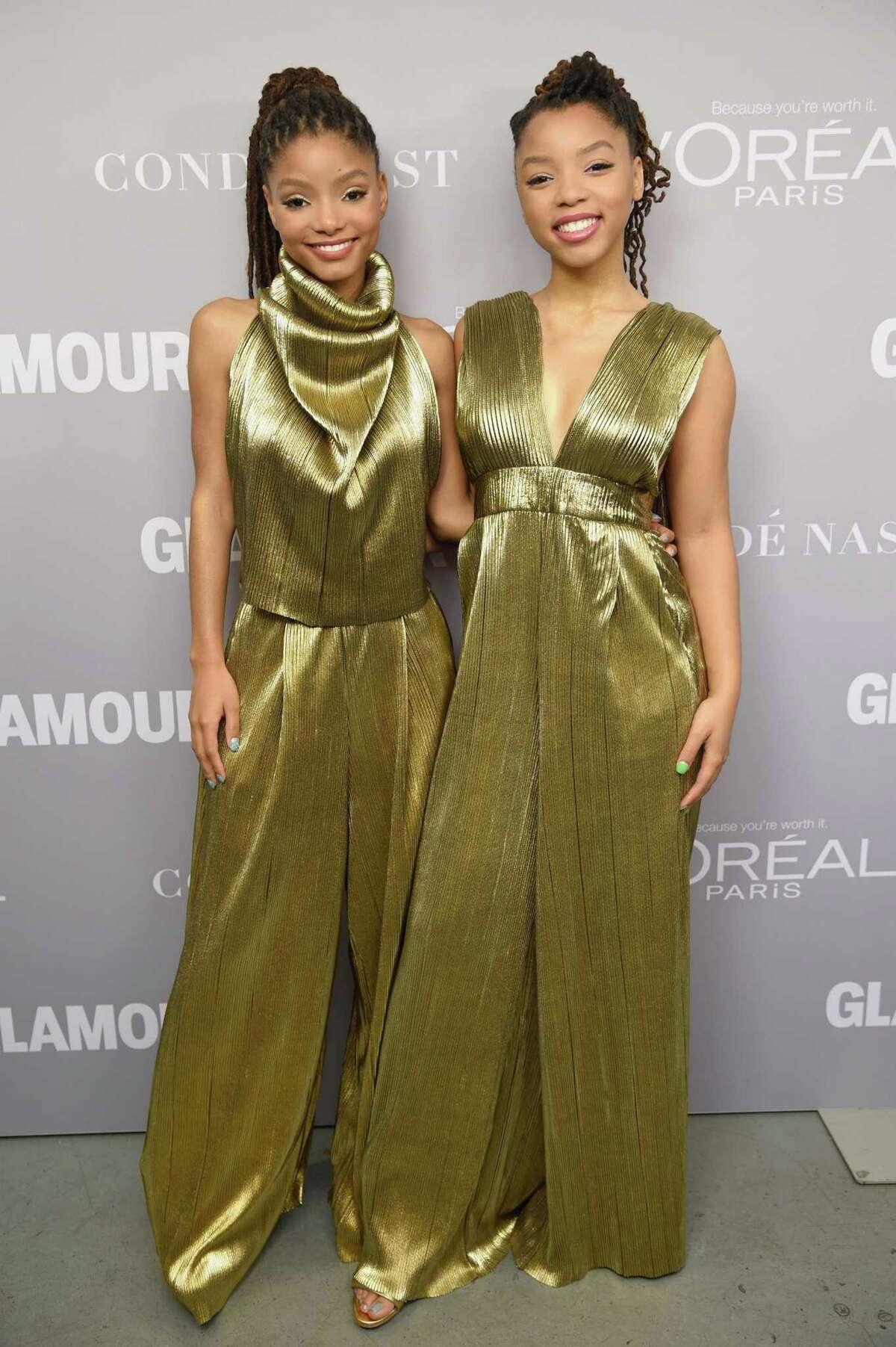 November 2017: Here, the pair wore stunning gold outfits at Glamour's Women of the Year awards. Chloe opted for a jumpsuit, while Halle went with a cowl neck top and pants.