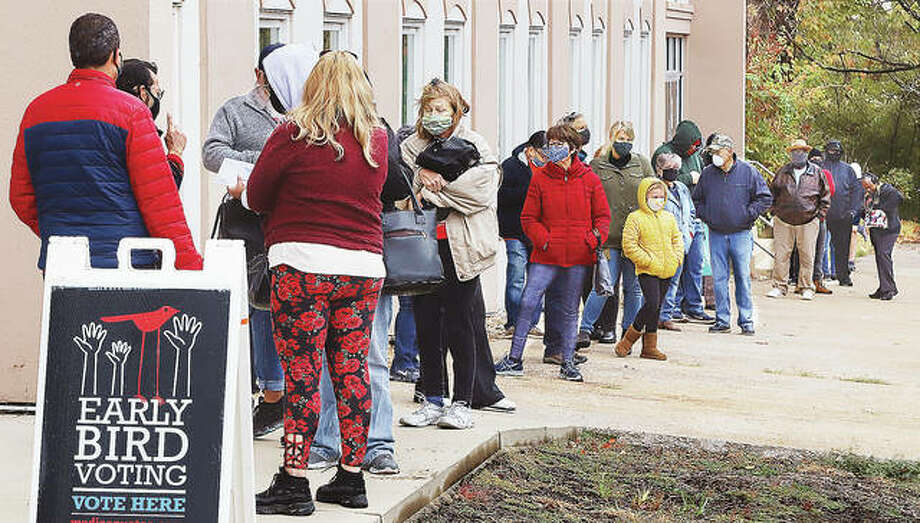 By 9 a.m. Monday morning, the first day of expanded early voting, about 80 people were lined up to vote inside the Scott Bibbs Center at 5th and Central in Alton. an equally large number of people were inside winding down the hallway to the voting room.
