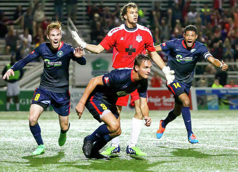 Saint Louis FC defender Sam Fink, center in front, and and teammates celebrate a goal in a previous game. STLFC lost to Louisville City SC 2-0 Saturday night in Louisville in a playoff game. The loss meant the end of the line permanently for STLFC, which will cease operations in advance of the MLS expansion St. Louis City SC, which will begin Major League Soccer play in 2023, Photo: STLFC