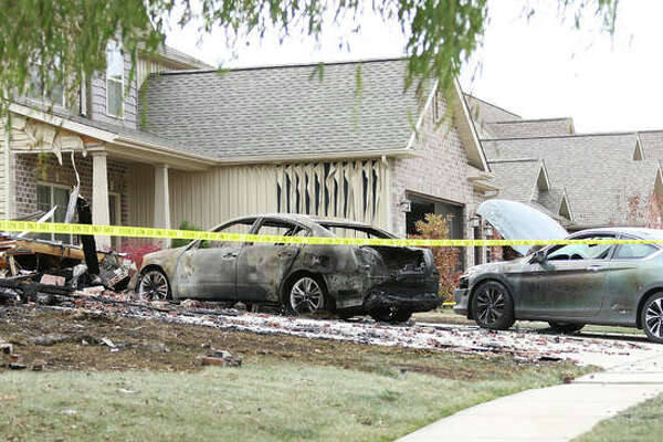 Two cars parked in the driveway of the home were not spared. Fire Chief Eric Wilson said two of the three cars at the scene Saturday were totaled, a third one may be totaled later.