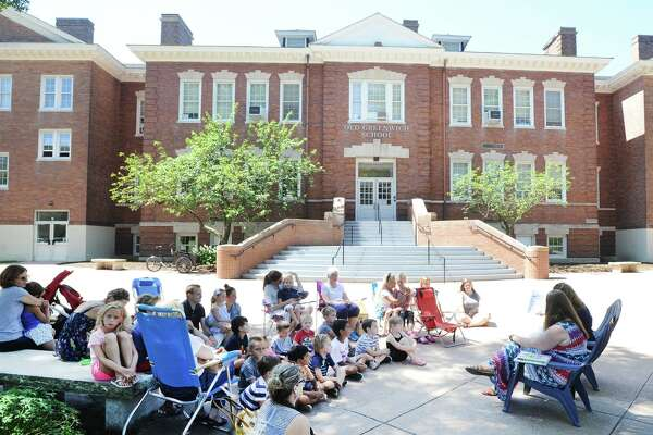 Story time reading session led by Old Greenwich School Principal Jennifer Bencivengo in front of the school for incoming students at the Old Greenwich School, Greenwich, Conn., Thursday, August 23, 2018.
