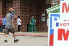A man flashes a thumbs up toward campaign workers as he walks to join the small, but steady line that flowed outside the Rogers Park Community Center Monday morning as the second week of early voting gets underway. Photo taken Monday, October 19, 2020 Kim Brent/The Enterprise