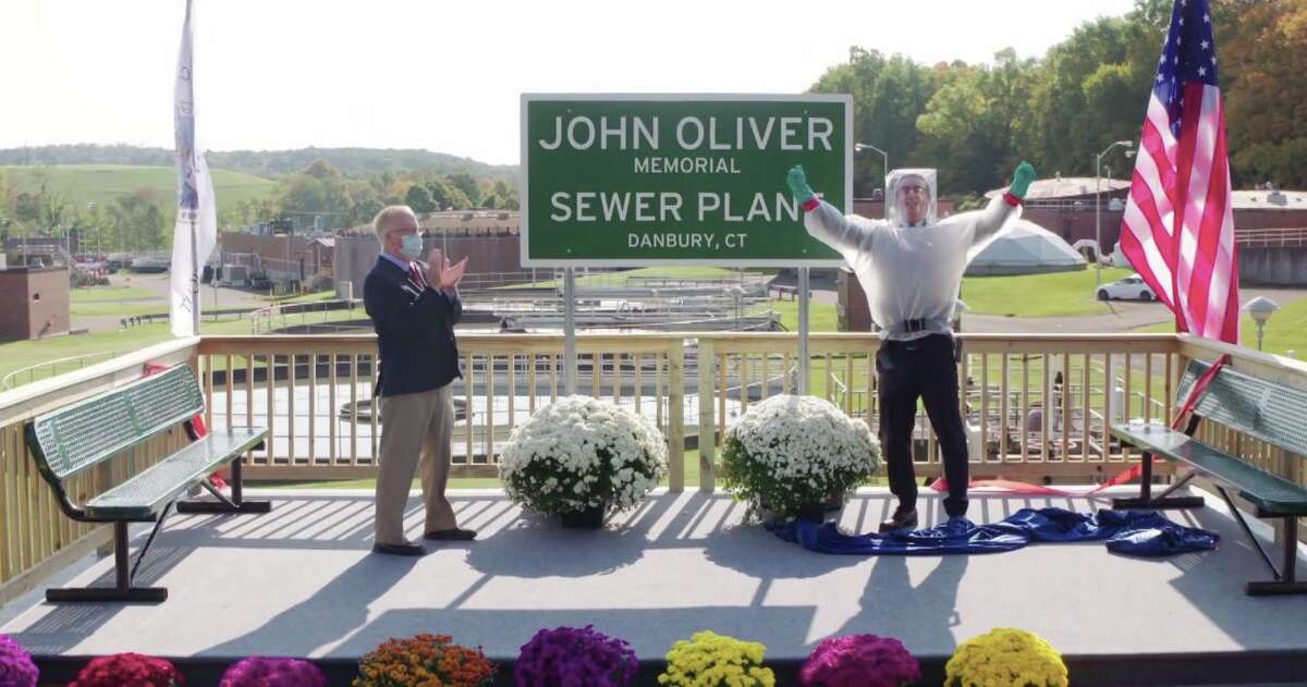 HBO comedian John Oliver and Danbury Mayor Mark celebrate after the ribbon is cut at the newly named