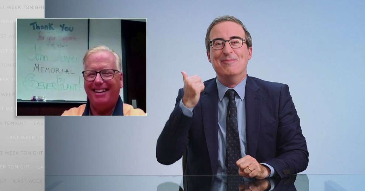 HBO comedian John Oliver and Danbury Mayor Mark celebrate after City Council voted to rename the wastewater treatment facility the