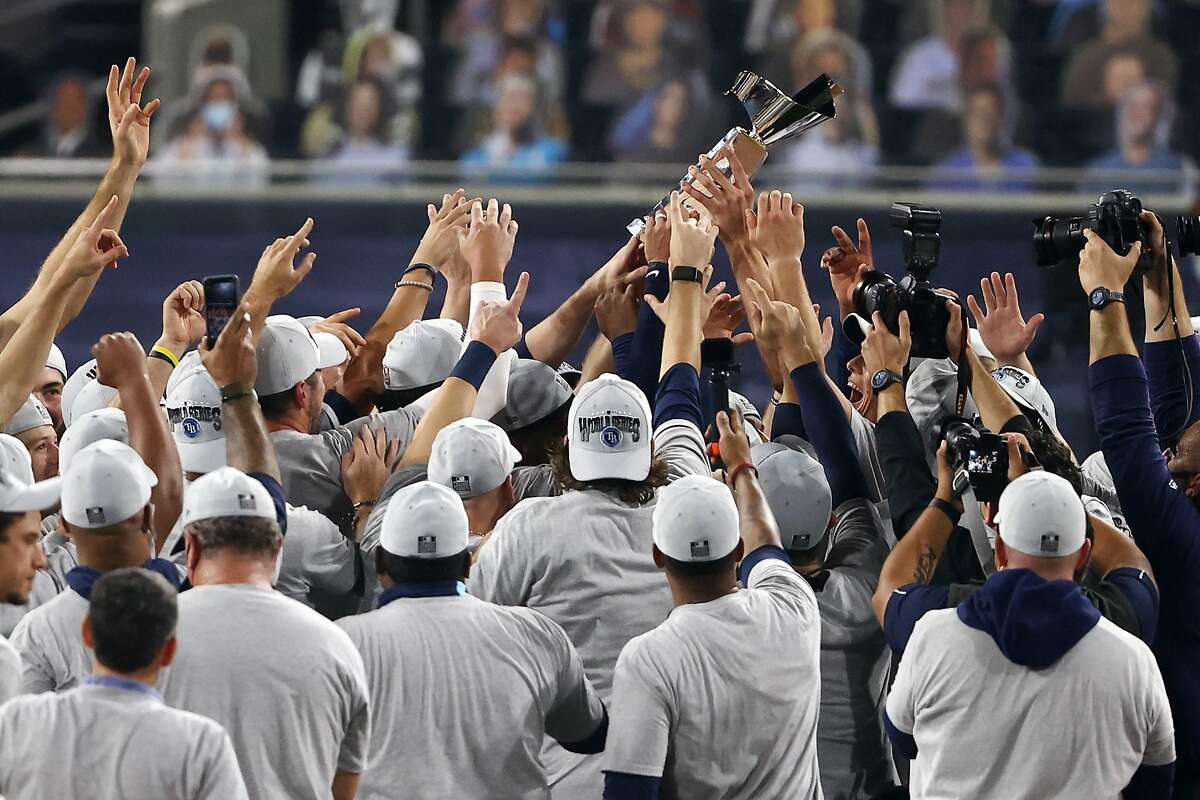 The Rays (above) knocked out the Astros in a Game 7, as L.A. did to Atlanta. The teams will meet in Texas for Game 1 on Tuesday night in just the second Series appearance for Tampa Bay.
