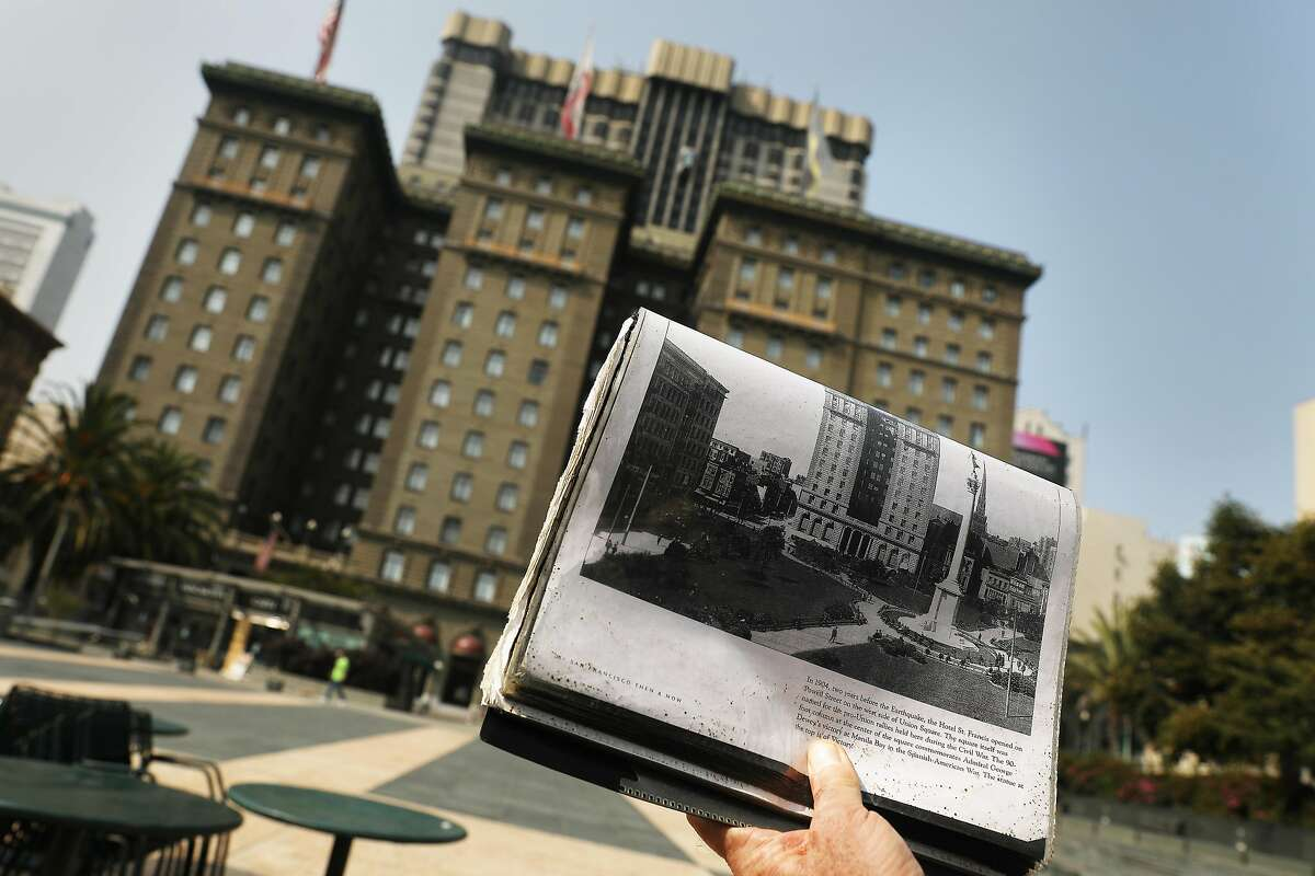Joseph Amster as Emperor Norton holds up a booklet with an archival photo of the Hotel St. Francis as he talks about it's history in Union Square on Wednesday, September 30, 2020 in San Francisco, Calif.