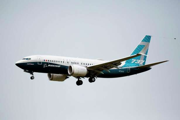 A Boeing 737 MAX airliner lands following an evaluation flight at Boeing Field in Seattle, Washington, on September 30, 2020. Stamford-based aerospace parts manufacturer Hexcel saw its third-quarter revenues plunge in part because of reduced demand for the 737 MAX.