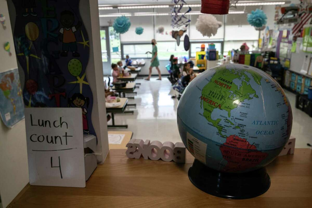 Children eat lunch at their desks, as a new coronavirus safety precaution on their first day of kindergarten at Rogers International School, a magnet K-8 school, on September 9, 2020 in Stamford, Connecticut.