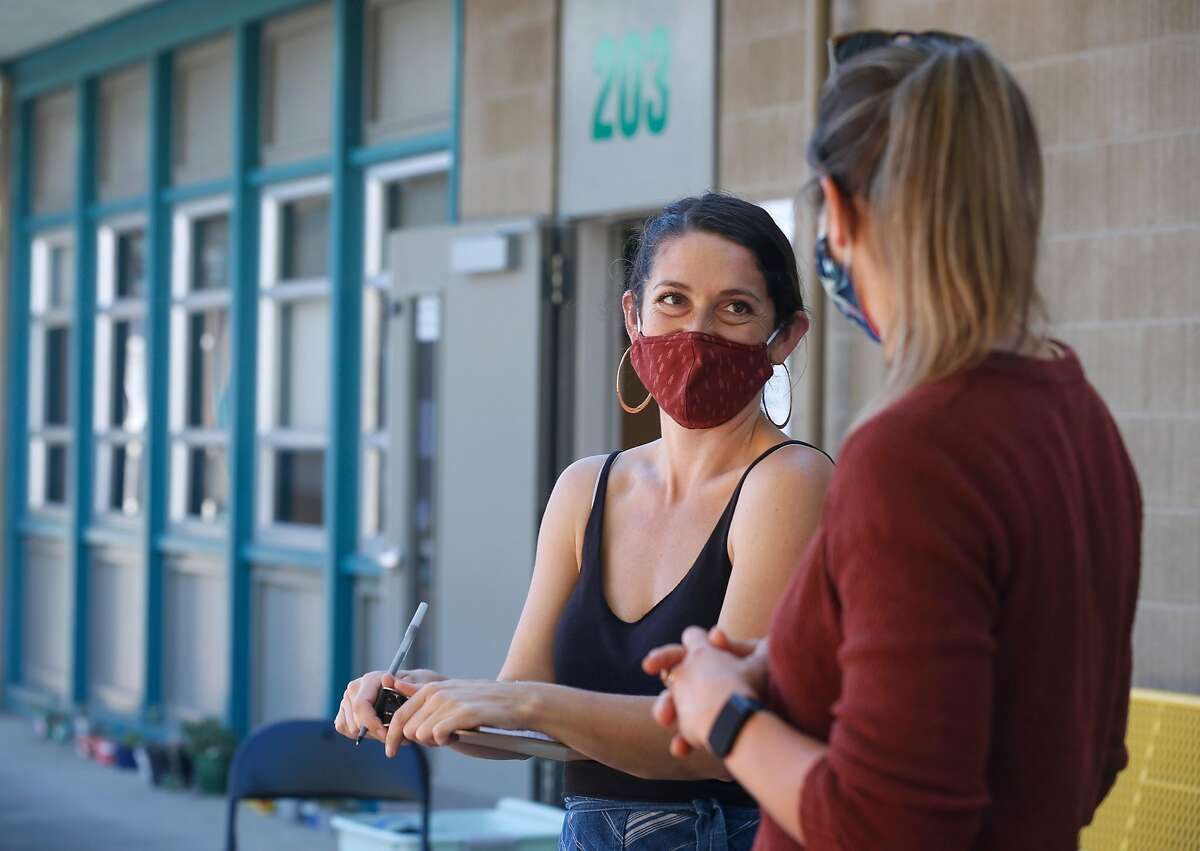 Jocelyn Boreta, co-founder of Botanical Bus: Bilingual Mobile Herb Clinic, speaks with translator Michelle Schromm at a mobile wellness workshop for Latino farmworkers in Santa Rosa.