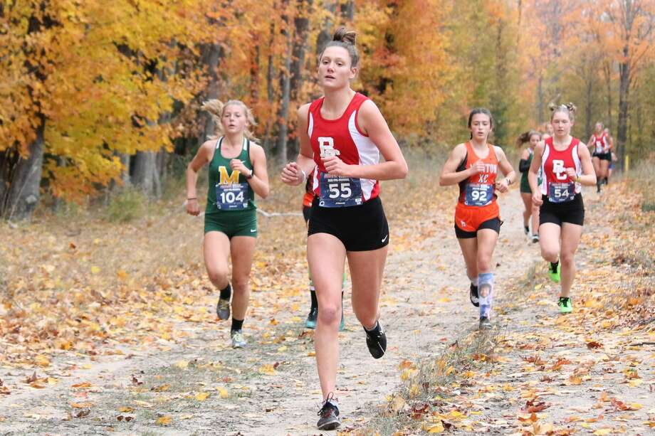 Benzie Central's girls cross country team crushes the competition to easily win their pre-regional meet on Oct. 19. Photo: Robert Myers