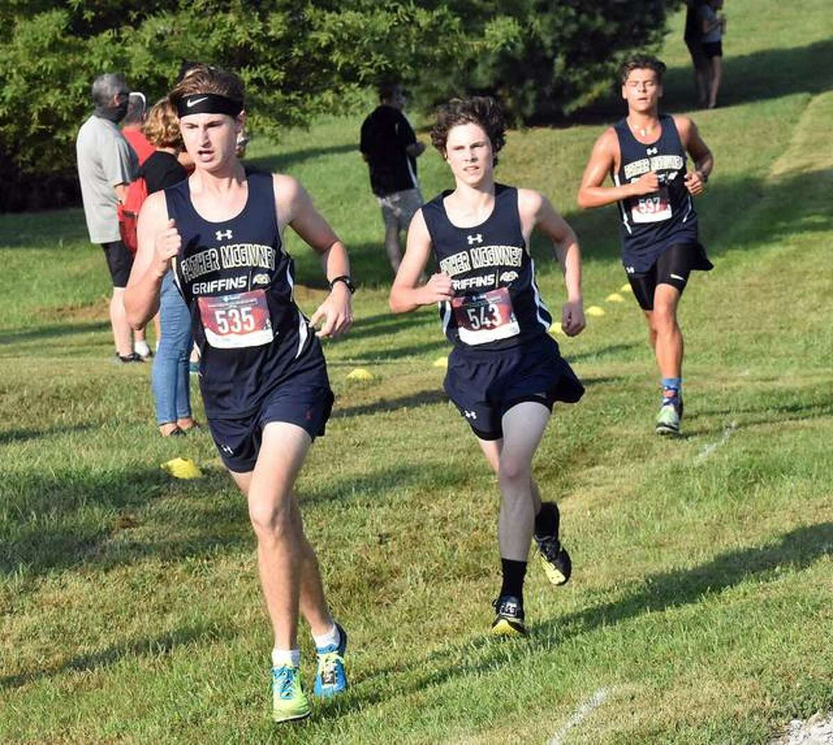Father McGivney's Noah Beltramea, front, Nolan Shearer, middle, and Andrew Dupy compete in the Bulldog Opener in Alhambra on Aug. 29.