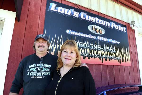 Lou Harris and his wife, Theresa, are photographed outside of Lou's Collision and Custom Paint in Old Saybrook on October 9, 2020.