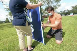 Jefferson County Democratic Party Chair Joseph Trahan places a new large Biden/Harris campaign sign at Rogers Park. Friday, he learned that two of the signs on site had been destroyed the night before. One had been burned and the other body-slammed to the ground. Video footage captured the incident and police are investigating. Photo taken Monday, October 19, 2020 Kim Brent/The Enterprise