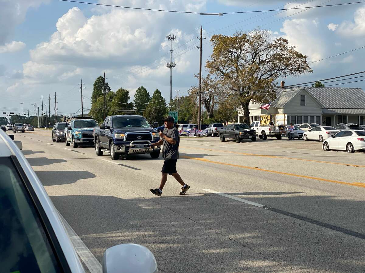 George Perez scurries across traffic after voting in Cypress.