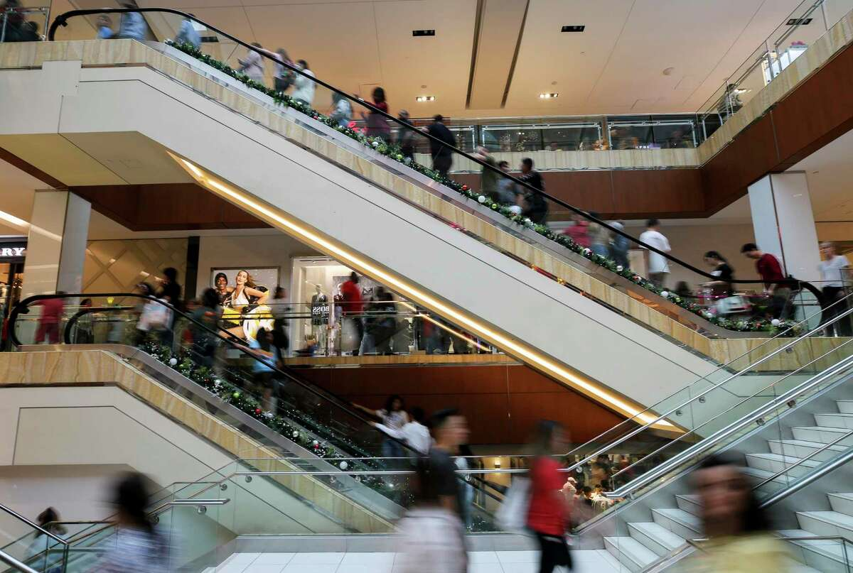 People shop for Black Friday deals at The Galleria mall Friday, Nov. 29, 2019, in Houston. Houstonians will spend about $1,201 per household on average this holiday season, 23 percent less than last year and below the national average of $1,387.