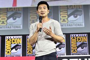 "FILE - Simu Liu of Marvel Studios' ""Shang-Chi and the Legend of the Ten Rings"" talks to the crowd at Comic-Con in San Diego on July 20, 2019."